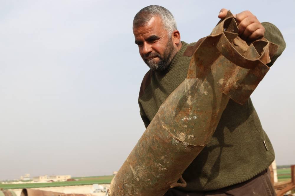 Suriye'de hayatını savaş hurdalarından kazanan insanlar 4