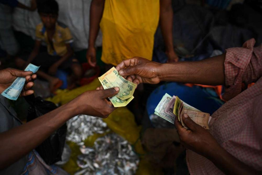 Rohingyalıların tehlikeli sularda hayatta kalma mücadelesi 18
