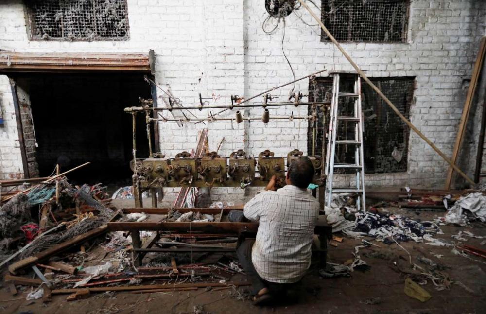 Hindistan'da dokuma fabrikalarının 'gariban' yüzü 11