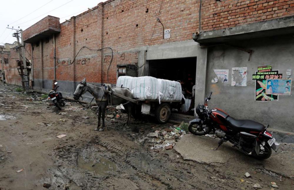 Hindistan'da dokuma fabrikalarının 'gariban' yüzü 13