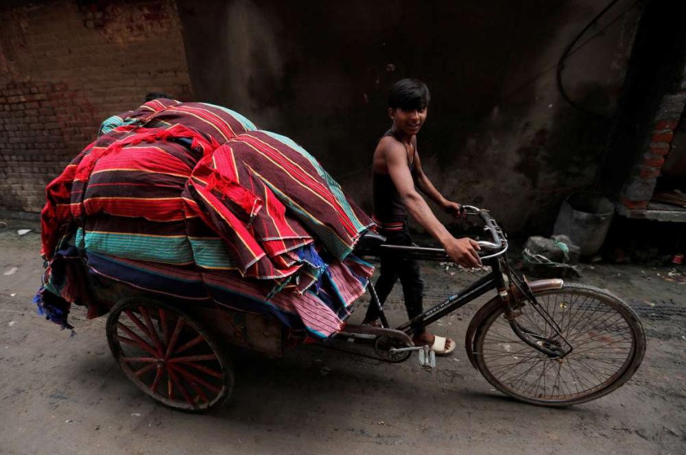Hindistan'da dokuma fabrikalarının 'gariban' yüzü 9