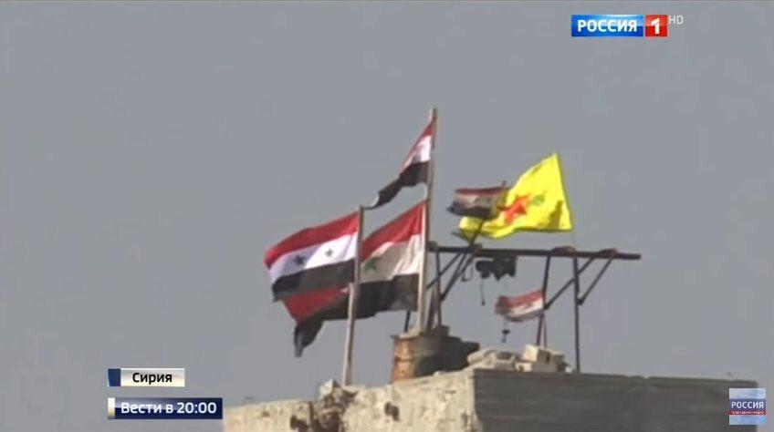 Halep'te rejim ve YPG bayrakları birlikte dalgalanıyor