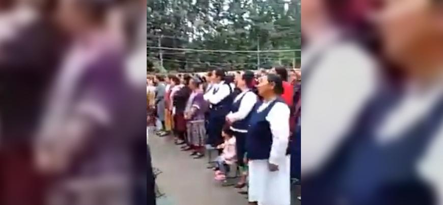 Çin, Uygur kadınların zorla başını açarak ulusal marş söyletti