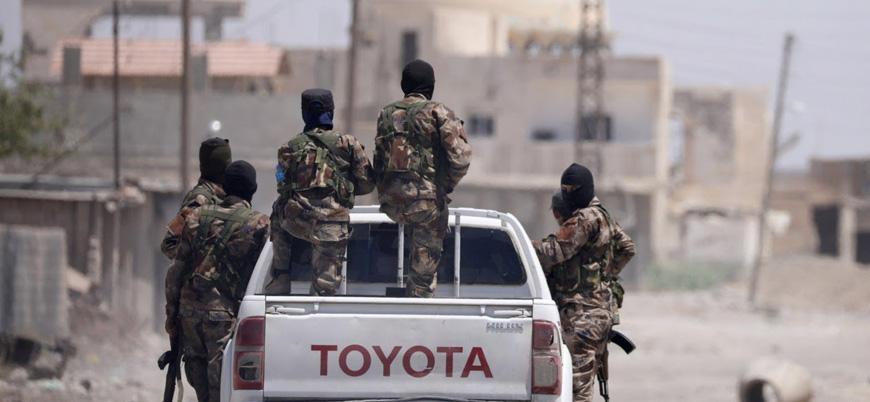 Esed rejimi YPG'nin çekilmesinden memnun