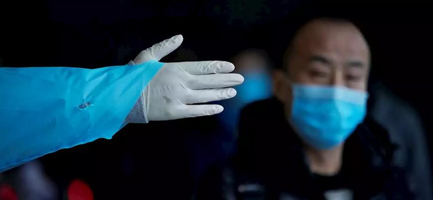 Koronavirüs: Çinliler evlerinde yaka paça gözaltına alınıyor