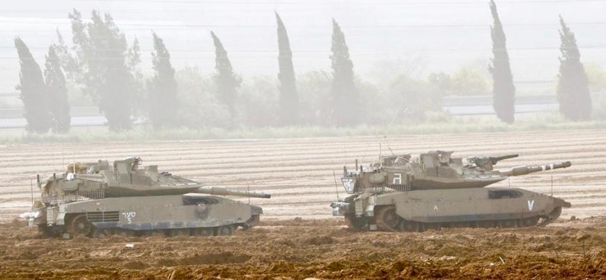 İsrail Gazze'de bir Filistinliyi öldürdü, cesedini buldozerle sürükledi