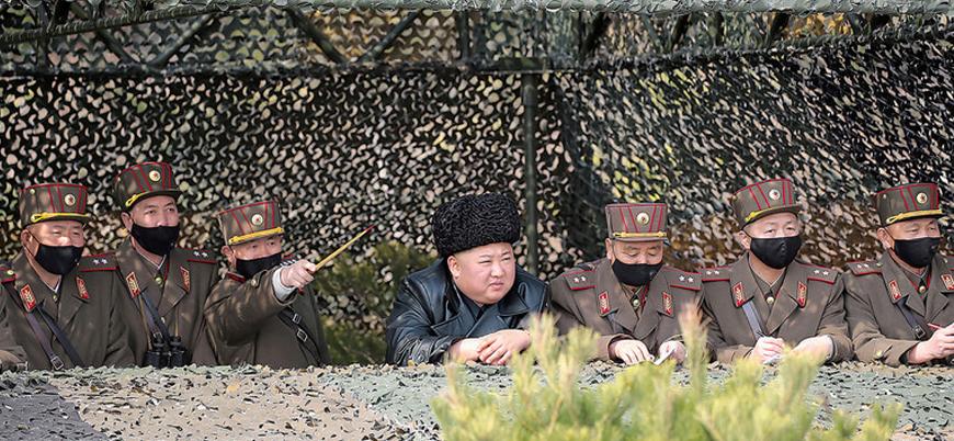 Dünya koronavirüs ile mücadele ederken Kuzey Kore lideri Kim Jong-un'dan 'maskesiz' tatbikat