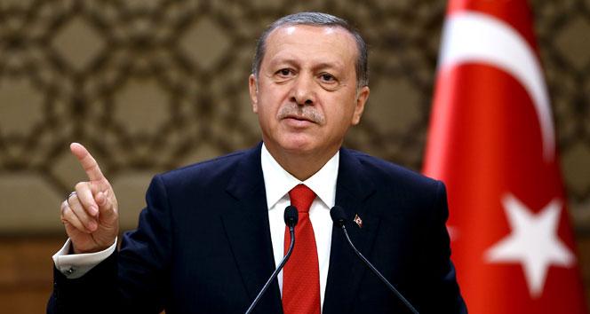 Erdoğan: Hainlerin kafasını kopartacağız