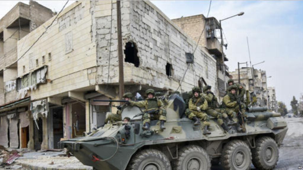 Rus askerleri 'ateşkes gözlemi' için Dera ve Guta'nın ardından Humus'ta